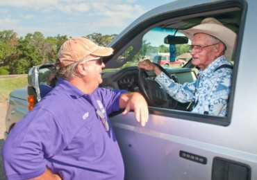 Joe Brashear, chairman of the U.S. National Hot Air Balloon Championship landowner relations committee, left, visits with Hack Thompson after balloons landed in Thompson's leased hay meadow Thursday in Gladewater.