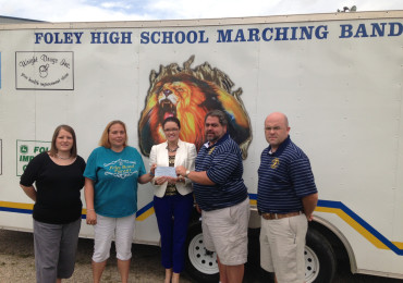 The Gulf Coast Hot Air Balloon Festival committee presented a donation to the Foley High School Band Boosters. At the presentation are, from left, Leslie McCormick, Foley High School Band Boosters treasurer; Melissa Feathers, Foley High School Band Boosters president; Kristin Roberson,South Baldwin Chamber of Commerce marketing/events manager; Carl Major, Foley High School band director; Jimmy O'Cain, Foley High School assistant band director.