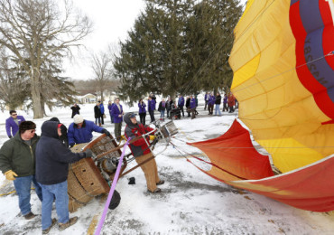 Jeremy King from Indianola and crew inflate a balloon for takeoff at the My Waterloo Days news conference.