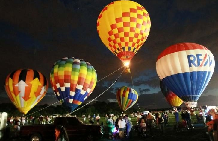 The morning weather at recent festivals kept the hot-air balloons grounded, but they have produced spectacular balloon glows during the evenings.