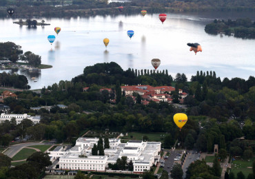 Hot air balloons float over Lake Burley Griffin during the Balloon Spectacular in Canberra, Australia, Saturday, March 8, 2014.