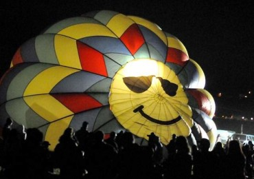 Dana Thornton cold air inflates his hot air balloon in preparation for the Dawn Patrol flight during the 2013 Great Reno Balloon Race.