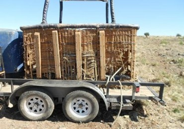 The basket of the wayward hot-air balloon is loaded on a trailer to return to the Verde Valley.