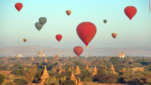 hot air balloons over Buddhist temples at sunrise. Bagan, Myanmar.