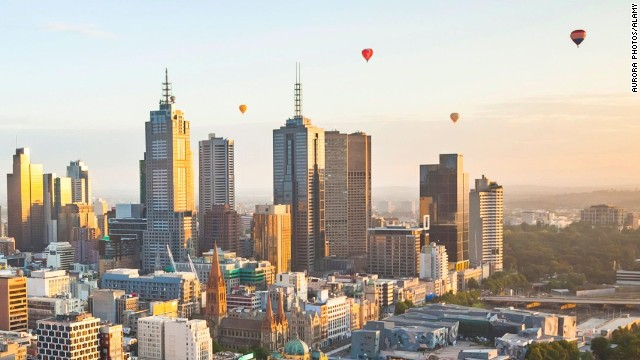 Hot air balloons aloft over Melbourne city at dawn, Victoria, Australia.