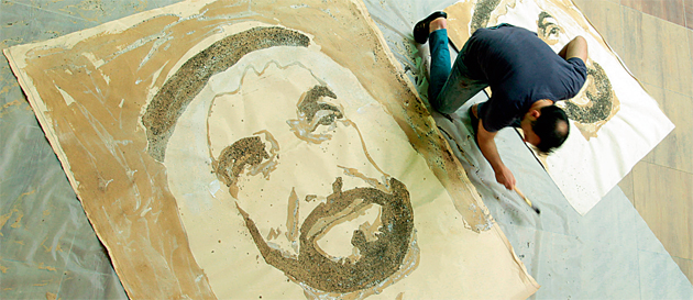 Tremblay working on the portrait of Shaikh Zayed.